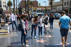 Ourists taking photos of stars in Hollywood Stock Image