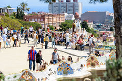 Ourists are visiting beautiful terrace at Park Guell in Barcelona, Spain. Stock Photo