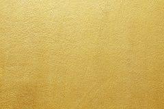 Ouro amarelo brilhante da folha do fundo da textura da parede Imagem de Stock Royalty Free