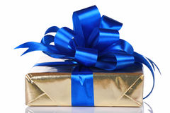 Ouro atual com fitas azuis foto de stock royalty free