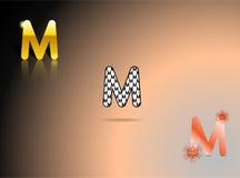 Ouro, cores preto e branco, alaranjadas com a letra M Fotografia de Stock Royalty Free