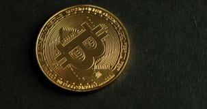 Ouro cripto Bitcoin da moeda - BTC - moeda do bocado Moedas criptos de Bitcoin da moeda dos tiros macro que giram filme