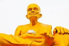 Ouro da Buda em um fundo branco imagem de stock