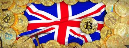Ouro de Bitcoins em torno da bandeira de Reino Unido e picareta no lef foto de stock royalty free