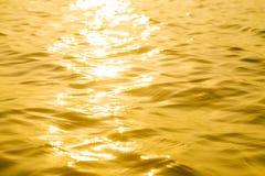 Ouro de superfície reflexivo solar abstrato Imagem de Stock