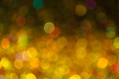 Ouro dispersado e bokeh amarelo Imagem de Stock Royalty Free