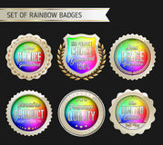 Ouro do arco-íris e crachá branco no fundo preto Fotos de Stock