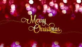 Ouro do Feliz Natal lustroso com a estrela no bokeh vermelho da cor de veludo fotografia de stock royalty free