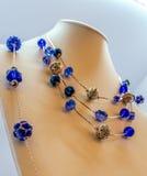 Ouro e colares azuis Foto de Stock