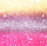 Ouro e luzes abstratas do bokeh do rosa foto de stock royalty free