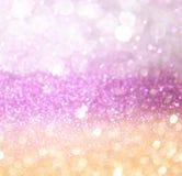 Ouro e luzes abstratas do bokeh do rosa. fundo defocused imagens de stock