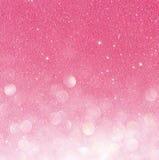 Ouro e luzes abstratas do bokeh do rosa Fundo Defocused fotos de stock royalty free