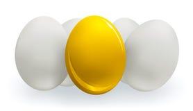 Ouro e ovos brancos Fotografia de Stock