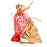 Ouro e sacos vermelhos do presente Imagem de Stock