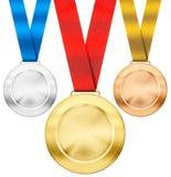 Ouro, prata, medalhas de bronze do esporte com fita Fotografia de Stock Royalty Free