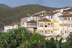 Ouro Preto. Buildings. Hills in the background. Green foliage in the foreground Royalty Free Stock Image