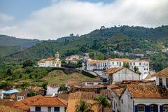 Ouro Preto stad och Merces de Cima Kyrktaga - Ouro Preto, Minas Gerais, Brasilien Fotografering för Bildbyråer