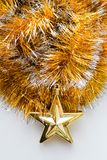 Ouropel do Natal com um brinquedo Fotos de Stock Royalty Free