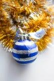 Ouropel do Natal com um brinquedo Imagem de Stock