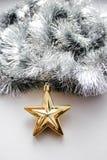Ouropel do Natal com um brinquedo Foto de Stock