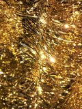 Ouropel do ouro do Natal imagens de stock royalty free