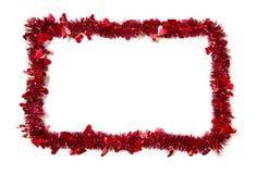 Ouropel vermelho com frame da beira dos corações Imagem de Stock