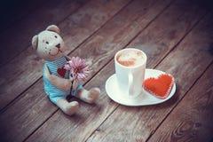 Ours avec la fleur Photographie stock