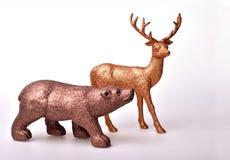 Ours de Brown et cerfs communs d'or Images libres de droits
