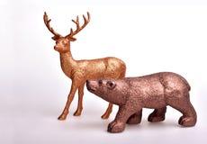 Ours de Brown et cerfs communs d'or Photos libres de droits