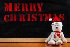 Ours de nounours avec le symbole de légende et le ` de Joyeux Noël de ` de message Images stock