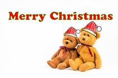 Ours de nounours avec le symbole de légende et le ` de Joyeux Noël de ` de message Photos libres de droits