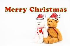 Ours de nounours avec le symbole de légende et le ` de Joyeux Noël de ` de message Photographie stock