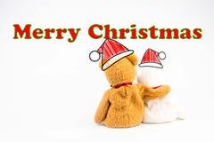 Ours de nounours avec le symbole de légende et le ` de Joyeux Noël de ` de message Photos stock
