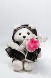 Ours de nounours avec un groupe de fleurs Photo stock