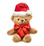 Ours de nounours classique avec l'arc et le chapeau rouges de Santa. Images libres de droits