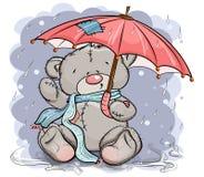 Ours de nounours dans une écharpe se reposant sous un parapluie Image stock