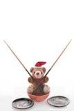 Ours de nounours de Noël avec des baguettes, paraboloïdes, cuvette. Photos libres de droits