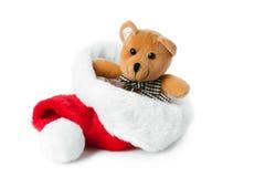 Ours de nounours et capuchon de Noël Photographie stock libre de droits
