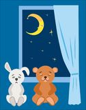 Ours de nounours et lapin de peluche à dormir pendant la nuit étoilée Photo libre de droits