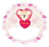 Ours de nounours mignon avec le cadre de coeur Images stock