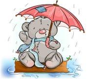 Ours de nounours se reposant sous un parapluie Images stock