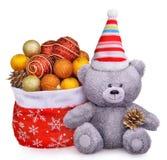 Ours de nounours souriant avec des jouets de Noël Images libres de droits