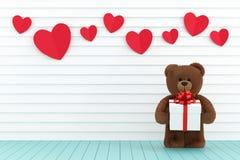 Ours de nounours tenant un boîte-cadeau Image stock
