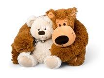 Ours de nounours tenu par un autre ours de nounours Photos libres de droits