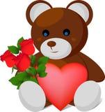 Ours de peluche avec le coeur et le bouquet rose Image libre de droits