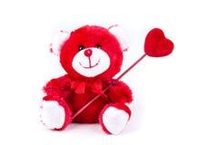 Ours de Valentine tenant un coeur sur un bâton Photo stock