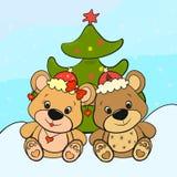 Ours - garçon et fille près de l'arbre de Noël Photographie stock