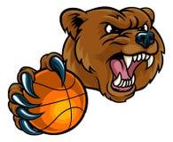 Ours tenant la boule de basket-ball Photos stock
