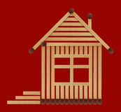Нouse from matches. It is small house from matches close up isolated on a red background Stock Photos