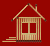 Нouse from matches. It is small house from matches close up isolated on a red background Stock Images